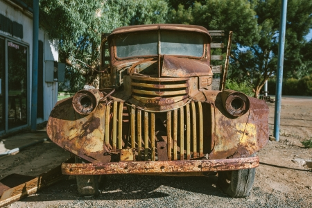 abandoned car: On our way back to Mildura from Wentworth, we came across this old truck parked under an awning rusting away with time.
