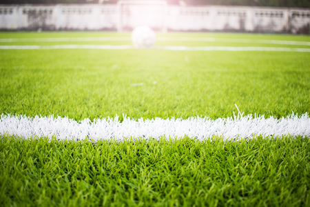 Artificial turf football field green white grid