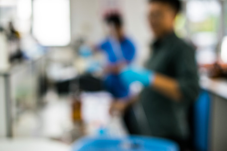 focus on background: Blur image of Two scientists working in a research laboratory for background Stock Photo