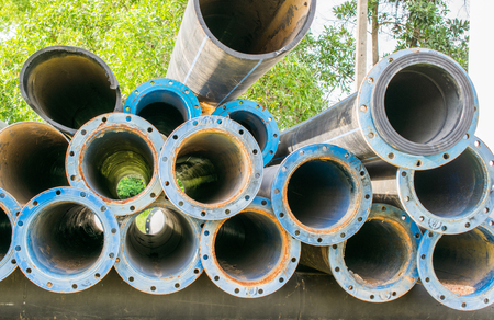 metal and hdpe water pipe Stock Photo
