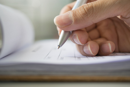 Hand with pen over application form.selective focus Stock Photo
