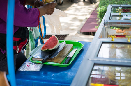 Costermonger Selling Watermelon,watermelon cut with a knife Stock Photo