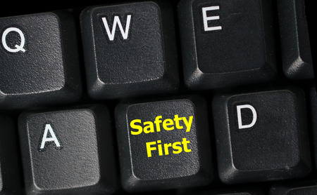 safety first concept with yellow key on computer keyboard Stock Photo
