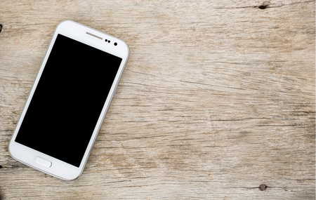 smart phone isolated on wood background. Stock Photo