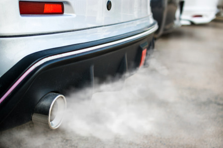 combustion fumes coming out of car exhaust pipe. Stock Photo