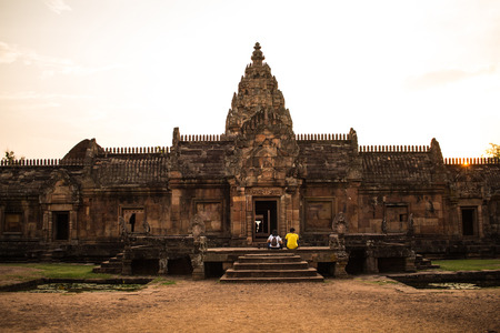 couple with sandstone castle, phanom rung in Buriram province, Thailand.