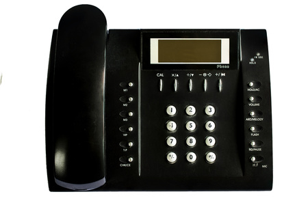Old Black office telephone isolated on white background