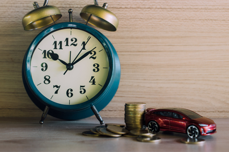 Red car and money coin stack growth with clock Stock Photo