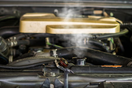 Hot steam coming out of Radiator, Car engine over heat. Stock Photo