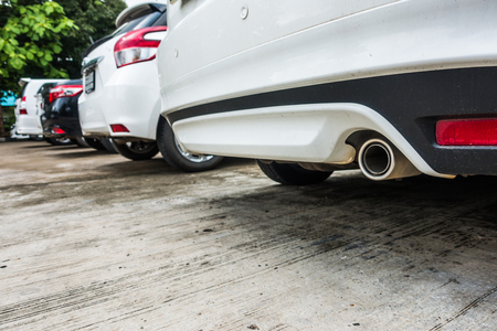 exhaust pipe of a white car