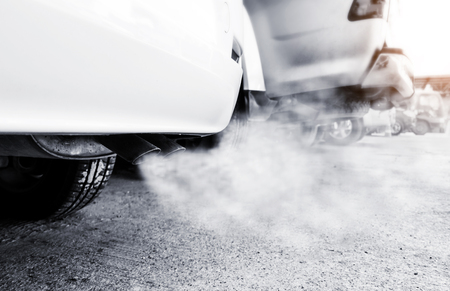 Car exhaust pipe comes out strongly of smoke, air pollution concept. Stock Photo