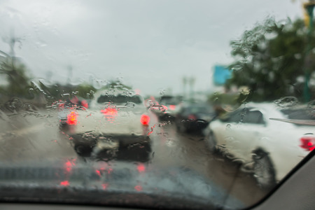 dense traffic on a rainy day with raindrops on car glasses.