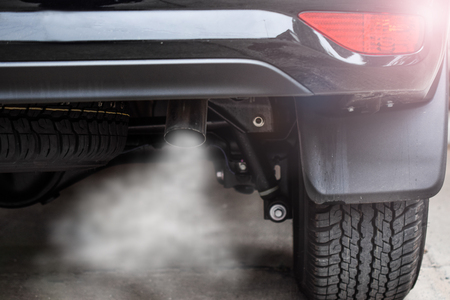Exhaust from black car , air pollution concept.