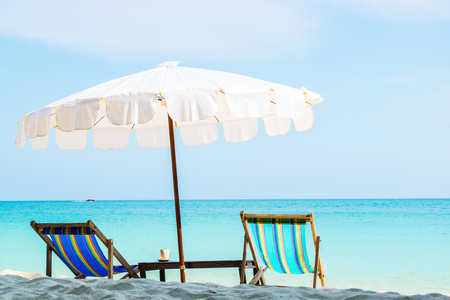 Colorful chairs and White umbrellas on the beach at Samed Island, Thailand. Stock Photo