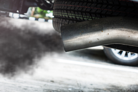 Exhaust from black car , air pollution concept. Stock Photo - 112030929