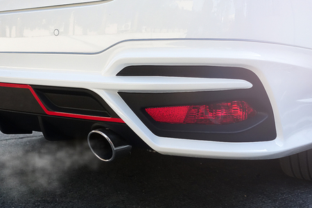 Air pollution particulate matter of 2.5 microns or less in diameter (PM 2.5)  from  Exhaust white car