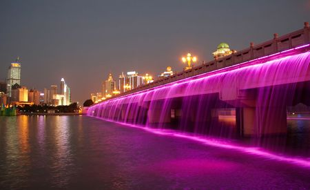 splendid bridge with colorful waterfall, the city of nanning, China
