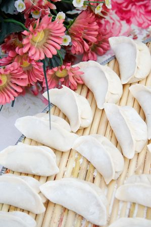 silver ingots: Chinese dumpling is one of the most important foods in Chinese New Year. Since the shape of Chinese dumplings is similar to ancient Chinese gold or silver ingots, they symbolize wealth.
