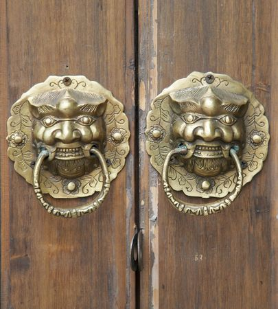 chinese door with a liondragon head photo