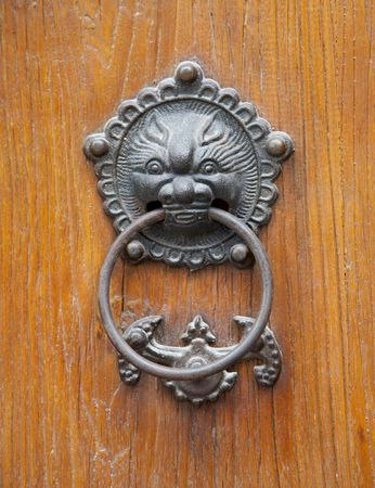 rusty liondragon head on Chinese traditional wood door. photo