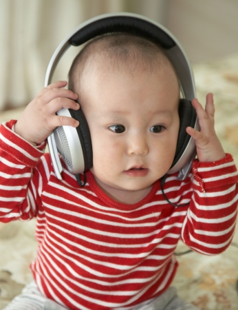 baby wearing a big earphone photo