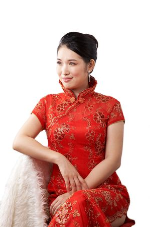 asian woman sitting and wearing traditional dress. photo