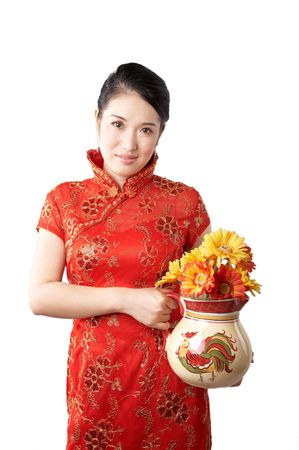 asian woman wearing traditional chinese dress and holding flowers Stock Photo - 4720223