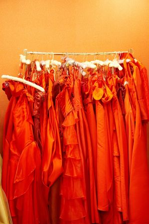 Red skirts,hanging in a store photo