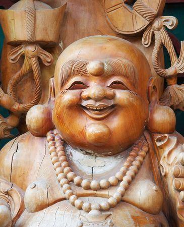 smiling buddha statue photo