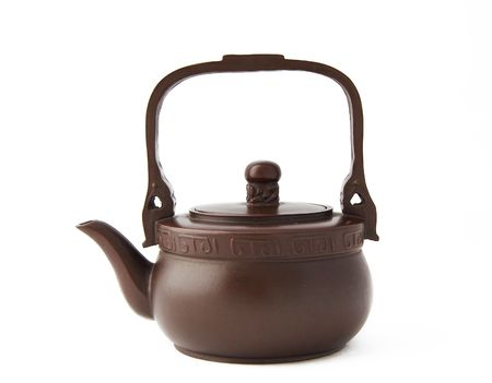 isolated clay teapot photo