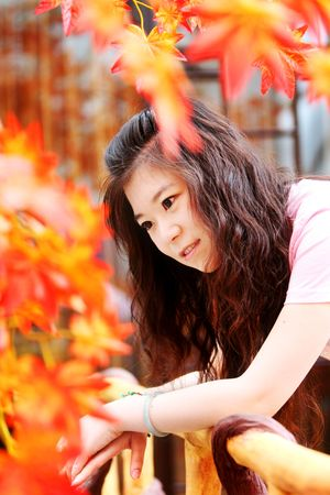WOMAN IN AUTUMN DAY  photo