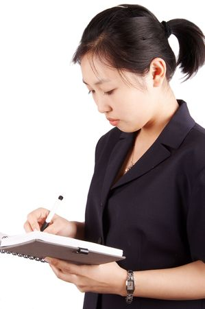 subordinated: Young secretary or business woman is writing on the notebook. Stock Photo