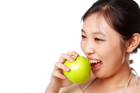woman eating green apple photo