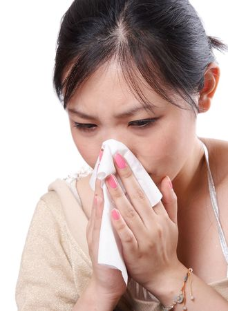 Sick asian woman blowing her nose with tissues, isolated on white photo