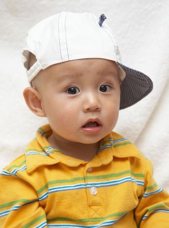 cute asian baby in a white hat Stock Photo - 4857838