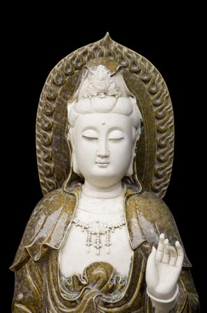 kuan yin statue on black background  photo