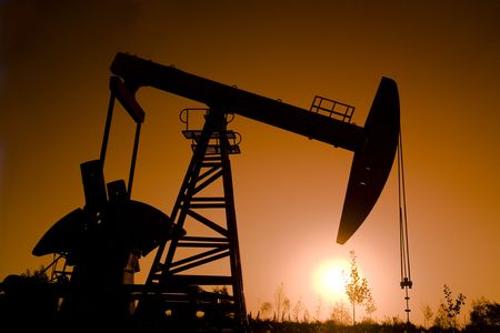 derrick: oil rig with sunset  Stock Photo