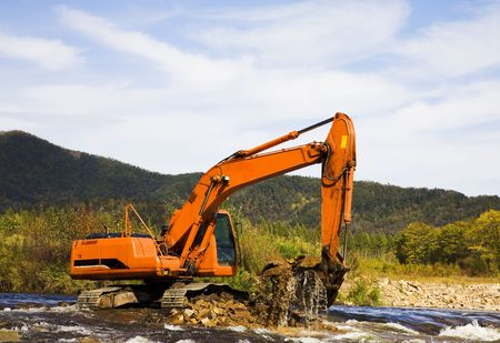 excavator dredging sediment mud  photo