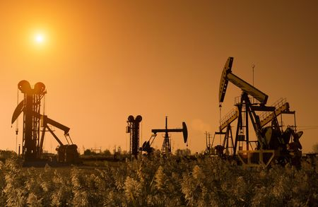 Silhouette of oil pump with sunset Stock Photo