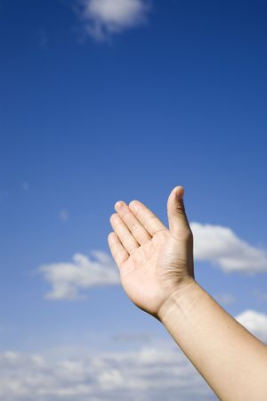 hand reaching up to the blue sky Stock Photo - 5983278