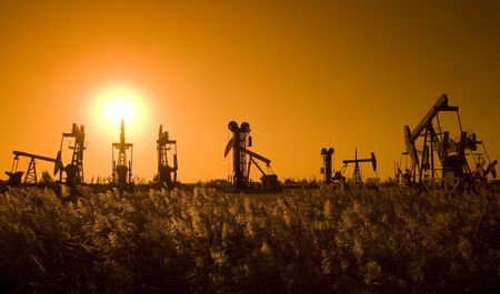 Silhouette of oil pump with sunset on the prairie  photo