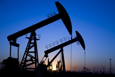 Silhouette of oil pump jacks with sunset Stock Photo - 5983279