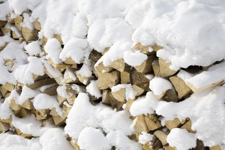 firewood covered by snow  photo