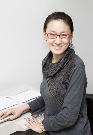 asian business woman working in office, and operating print machine. photo