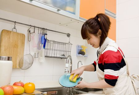 stereotypical housewife: washing dishes