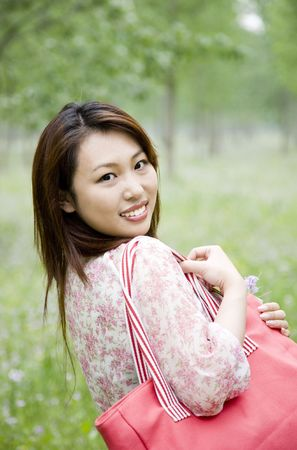young woman carrying shopping bag  photo