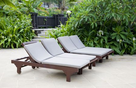 Lounge chairs in the garden photo