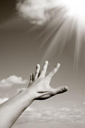mano de dios: alcanzar el cielo  Foto de archivo
