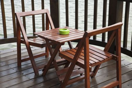 front or back yard: Patio with table and chairs by the lakeside