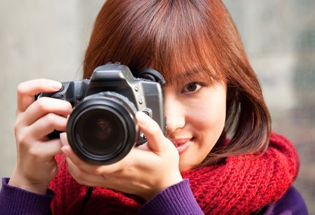 look at camera: Female photographer